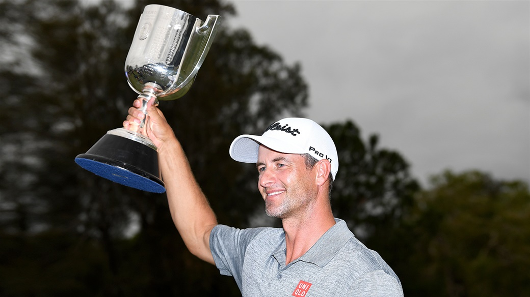 Adam Scott raises the champion's trophy after winning the 2019 Australian PGA Championship.