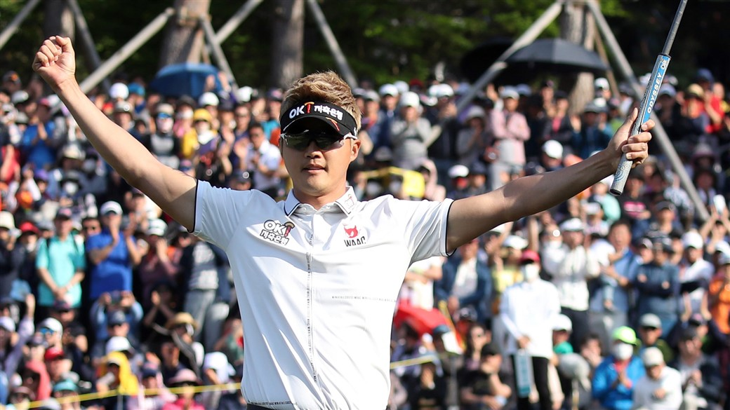 HaeTee Lee raises his arms in triumph after claiming victory at the 2019 GC Caltex MaeKyung Open