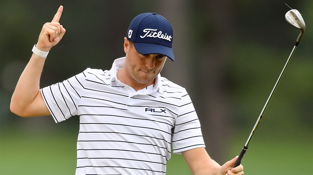 Justin Thomas raises his Vokey SM& wedge after chipping in for birdie at the 2019 BMW Championship