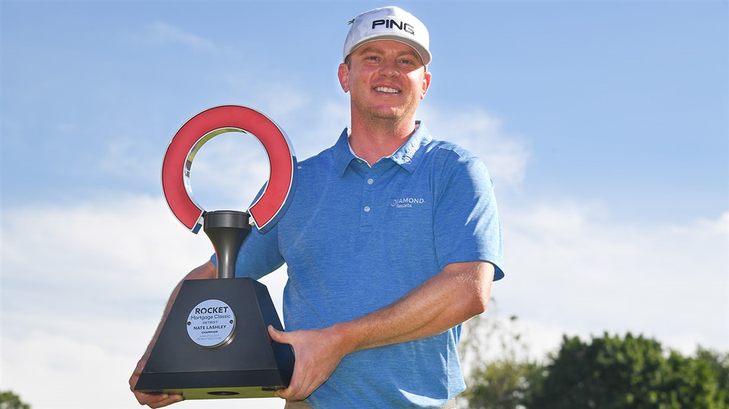 Nate Lashley raises the winner's trophy at the PGA TOUR's Rocket Mortgage Classic