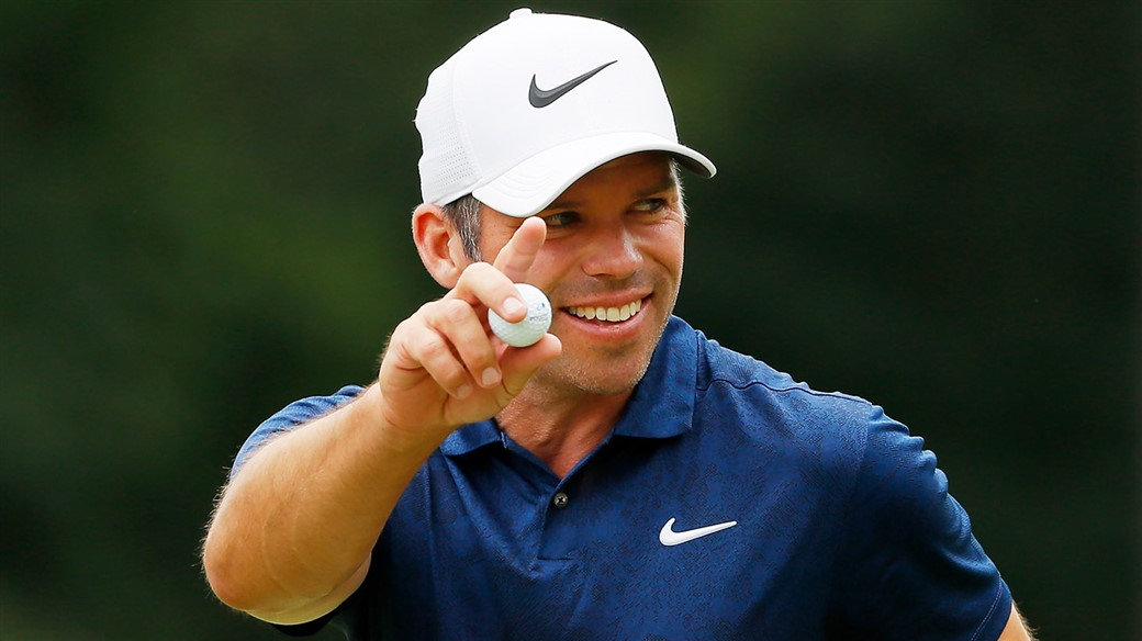 Paul Casey salutes the gallery with his Pro V1 golf ball after holing a birdie putt during action at the 2019 Porsche European Open
