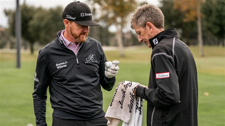Jimmy Walker examines a new Pro V1x golf ball prototype during testing with Fordie Pitts, Titleist Tour Consultant for Golf Ball R&D