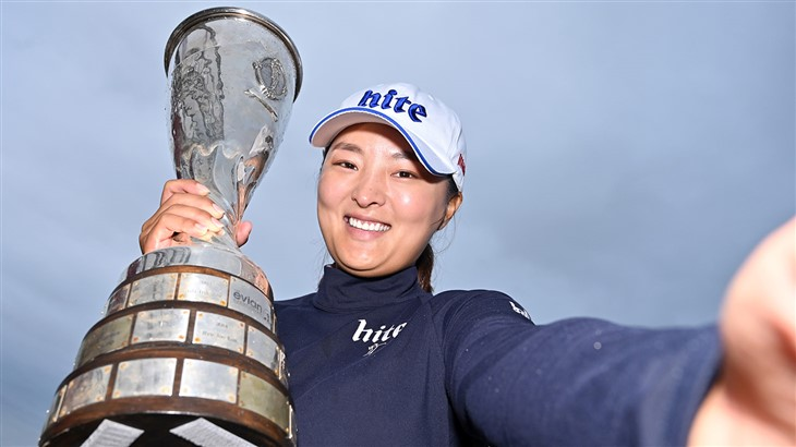 Jin Young Ko embraces the trophy after winning the 2019 Evian Championship.